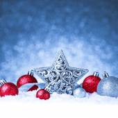 Christmas ornament in snow on glitter background — Stockfoto