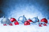 Christmas ornament in snow on glitter background — Stock Photo