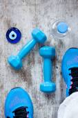 Dumbbell and sneakers — Stock Photo