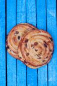 Sweet bun with raisin — Stock Photo