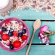 Muesli in bowl on table — Stock Photo #66645531