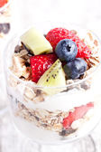 Muesli with yogurt and fruits — Stock Photo