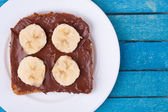 Bread with chocolate spread and banana — Stock Photo