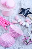 Sugar coated candies, cupcake baking cups, macaroons, pink straws — Stock Photo