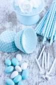 Sugar coated candies, cupcake baking cups, straws — Stock Photo