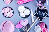 Meringues, Sugar coated candies, cupcake baking cups — Stock Photo