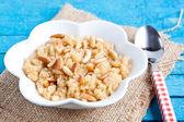 Semolina halvah with pine nut — Stock Photo