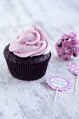 Pink chocolate cupcake — Stock Photo