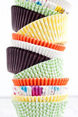 Colourful paper baking cups — Stock Photo