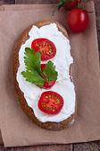 Bread with mild cream cheese — Stock Photo