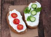 Bread with mild cream cheese — Stock Photo