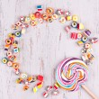 Assorted colourful candies and lollipop — Stock Photo #72234349