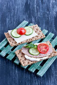 Crisp bread with cheese and smoked turkey meat — Stock Photo