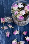 Tea with rose buds — Stock Photo