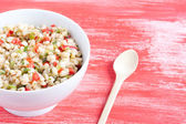 Wheat salad and spoon — Stock Photo