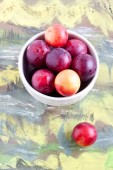Plums in a bow close up — Stock Photo