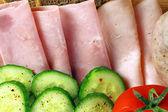 Tomatoes, cucumber, ham and white sausage — Stock Photo