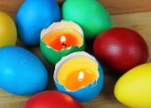 Easter eggs-candles with over eggs — Stock Photo