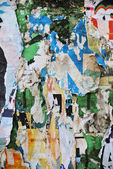 Random collage or over-layered papers wall background texture — Stock Photo