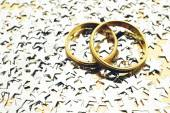 Gold rings with stars on background — Stock Photo