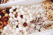 Pearls and vintage jewelry — Stock Photo