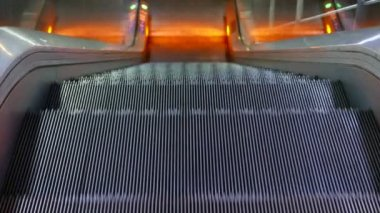 Escalator with orange lights — Stock Video
