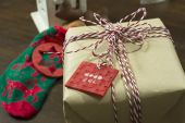 Craft paper gift box, tied with cord spool, red and white, and a — Stock Photo