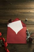 Red envelope, white note and Christmas decoration — Photo