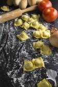 Raw ravioli on black background — Stock Photo