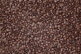 Caffe edition, coffee beans on a wooden background — Stok fotoğraf