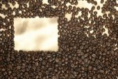 Caffe edition, coffee beans on old paper — Stock Photo