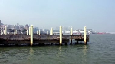 Mooring posts at Macau Fishermans Wharf and view of Outer Harbour Ferry Terminal — Stock Video