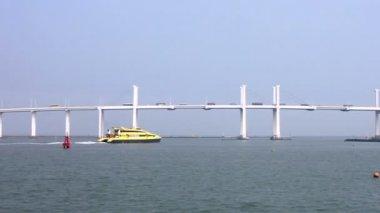Jetfoil sailing under the Friendship bridge in Macau — Stock Video