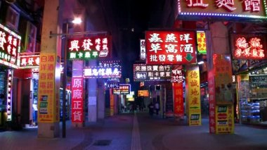 Macau - 19 October 2013: Colorful LED shop signs at night — Stock Video