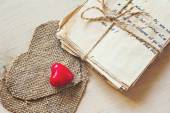 Vintage love letters and hand made heard on old board — Stock Photo
