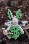 Soft toy - bunny sitting on an old tree. — Stock Photo