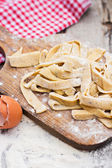 Homemade spaghetti, pasta or noodles on wooden table. Preparation — Stock Photo