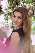 Woman in spring blossom. Young naturally beautiful woman near the blooming tree in spring time. Eco beauty and health concept. — Stock Photo