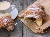 """A cup of coffee """"espresso"""" and croissant on the wooden table. Tonned photo. — Stock Photo"""