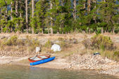Canoe and rowing boats at a dam near Somerset Wes — Stock Photo