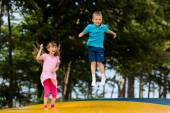 Kids at bouncy pillow — Stock Photo