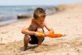 Young boy with plastic shovel — Stock Photo