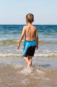 Boy playing in the ocean — Stock Photo