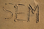 The word SEM written in the sand — Stock Photo
