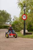 Boy driving buggy cart — Stock fotografie