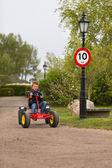 Boy driving buggy cart — Stock Photo