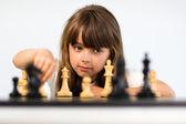 Girl playing chess — Stock Photo