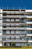 Apartment building with scaffold — Foto Stock