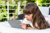 Girl looking at tablet — Stock Photo