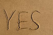 Yes written in sand — Stock Photo